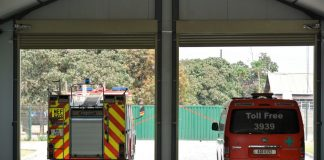 A fire engine and ambulance leaving their station
