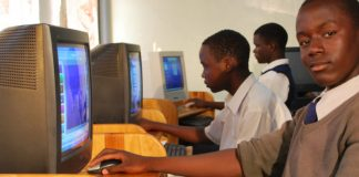 School kids receiving computer training