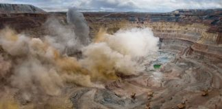 a picture of open pit mine blasting