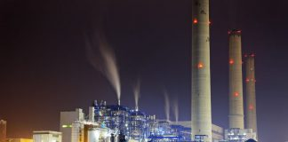 power station at night with smoke, hong kong