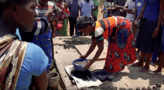 A woman in the process of making Green Charcoal in Zambia