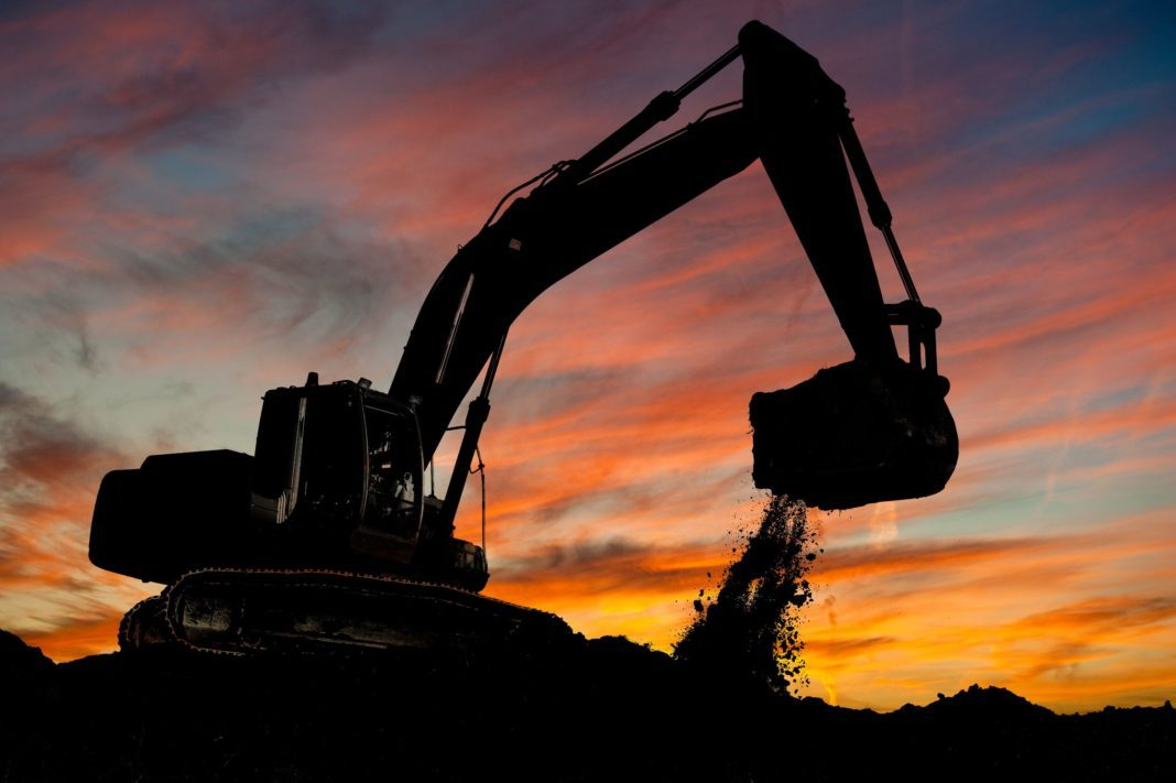 An excavator working on the mining investment