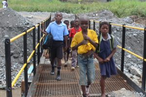 Children crossing the completed bridge